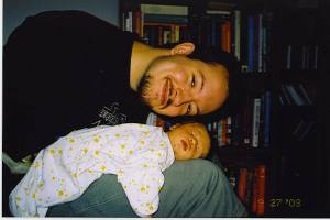 My husband and first baby during the first tender postpartum days.
