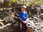 Zander sitting on some cool rocks.