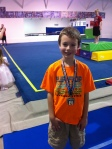 Lann finished his first year of gymnastics and got a medal at their spring show!