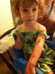 "For his birthday party, I ordered movie makeup supplies ala Face Off and Alaina jumped in on the action and made herself have a ""ceepy arm."""