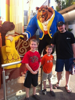 At the Lego store at Downtown Disney (and, yes, he's holding my purse because it was heavy).