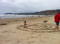 Walking a sand labyrinth with daddy.