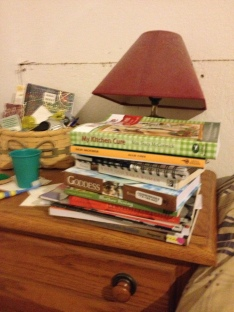 My to-read pile by the bed.