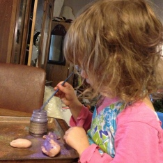 Helping mama with clay.