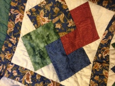 Quilt on my bed by my grandma.