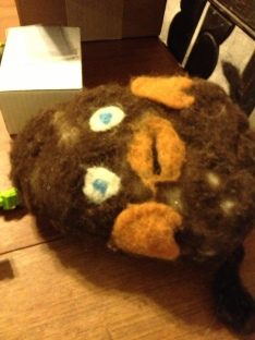 """Needle-felted """"O Zander"""" creation sitting on the table--collaborative creative project of the boys."""