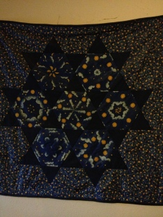 Birth quilt by my grandma on wall of boys' room.
