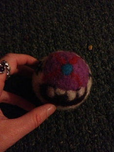 Felted monster ball on floor of living room--maybe my mom, maybe my son?