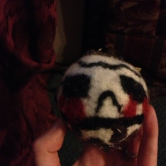Felted monster ball by one of the kids---note nifty spike hair.