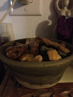 Bowl of random rocks in kitchen (pottery by my mom).