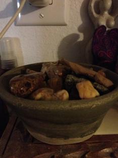 Bowl of random rocks in kitchen (pottery by my mom).
