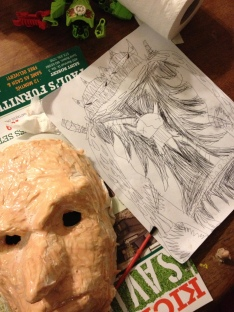 Next to mask in progress is another drawing.