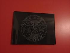 Birth mandala drawing on living room wall.