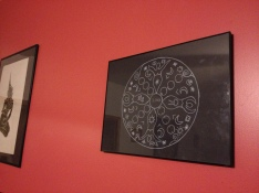 Moon calamandala on living room wall.