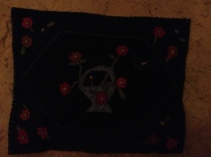 Penny rug by me on bedroom wall.