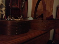 Boxes/carriers by my dad on dresser.
