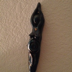 Goddess talking stick by me on bedroom wall.