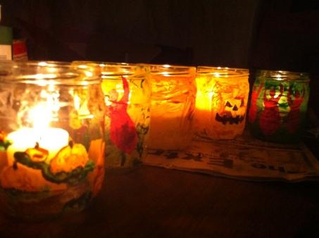 We painted parmasean cheese jar luminaries.