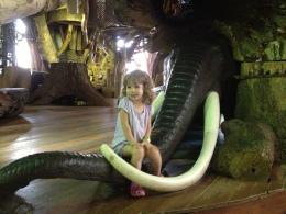Sitting on a mammoth trunk.