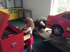 Alaina's favorite part of the Children's Village was this car repair shop.
