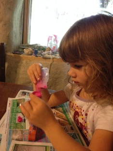 Today Alaina wanted to work on her Hello Kitty sand bottles from her aunt. She was very diligent.