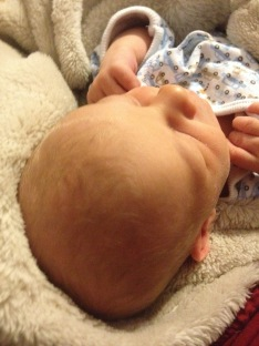 Alaina took this pic of his sweet little (apparently blonde!) head.