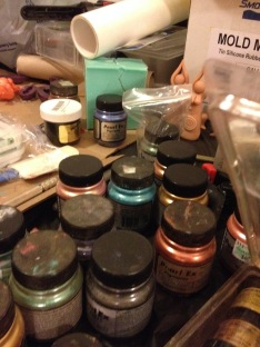 Mica pigments we use for color, while goddess prototype wait in the background.