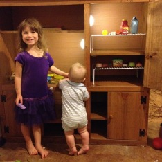 """""""Helping"""" Alaina with her cool new kitchen. My dad made it out of an old entertainment center. So much cooler than a plastic, store-bought one!"""