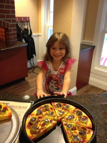 Alaina was SO excited to get back and work in the mini pizza restaurant again.